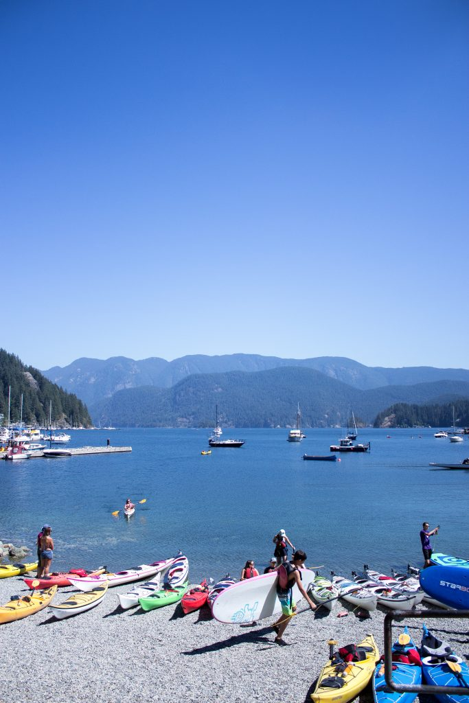 people preparing to kayak and paddleboard the Indian Arm in Deep Cove