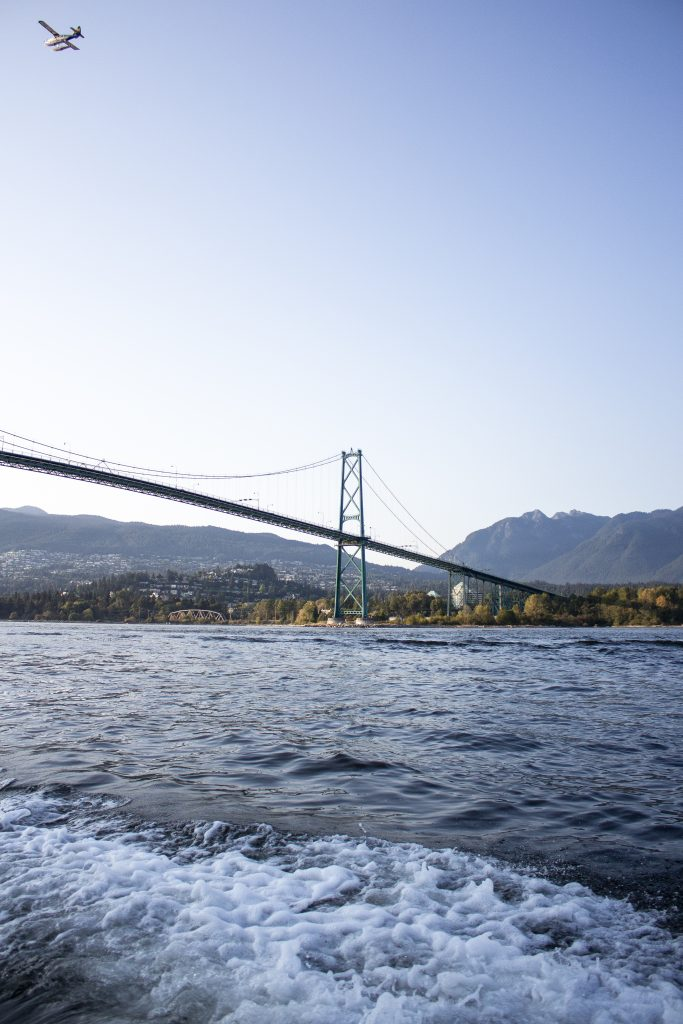 The Lions Gate Bridge and West Vancouver shown from a boat down the Burrard Inlet