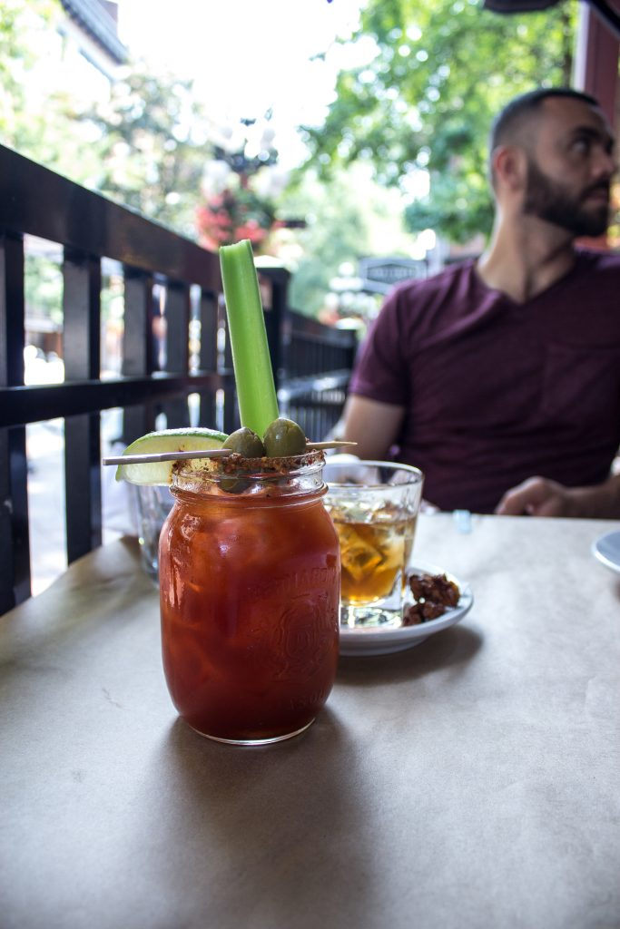 A bourbon caesar and walnut old fashioned served at The Flying PIg