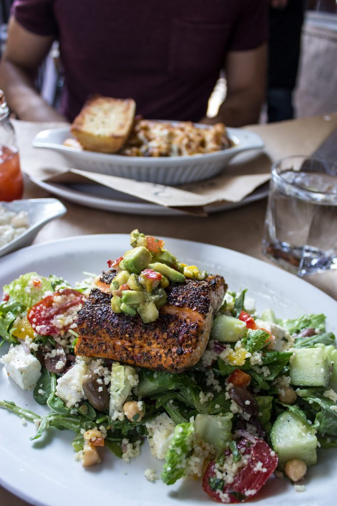 A trout fillet served over a bed of salad at The Flying Pig